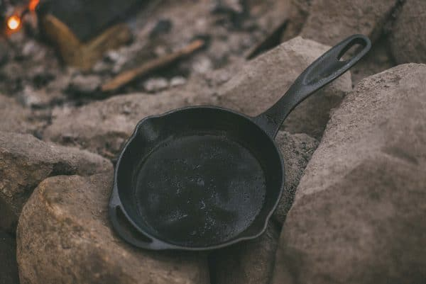 """8"""" Cast Iron Camping Pan on stones"""