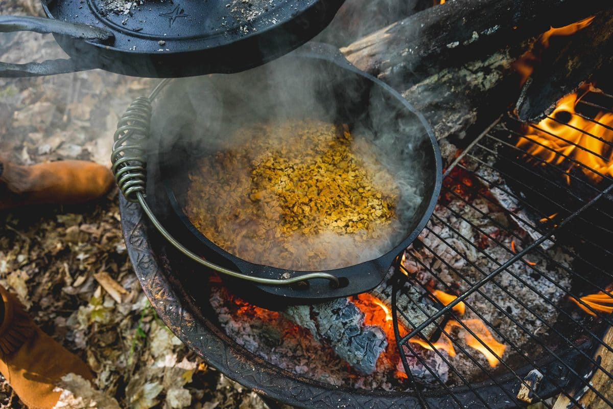 Cooking with Cast Iron Dutch Oven on Fire