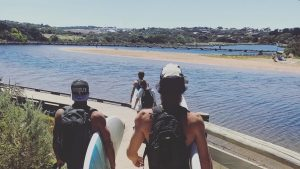 Carrying surfboards at Torquay
