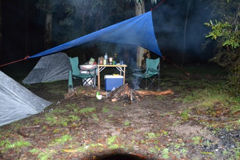 Camping at Cooks Mill with a fire under the tarp