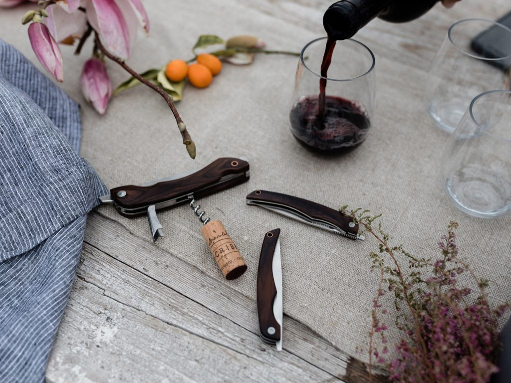 Folding Steak Knife next to Bottle Opener