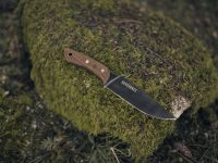 Field knife on moss covered rock