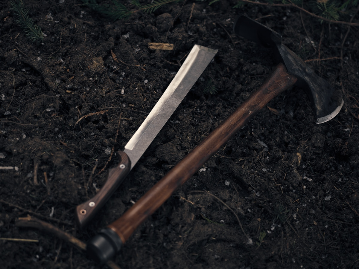 Machete laying next to sheath outside