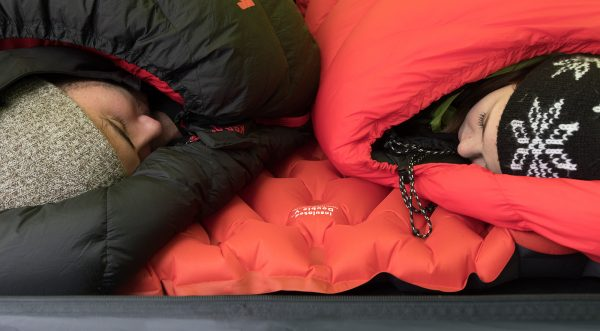 Two people camping on Double Sleeping Pad