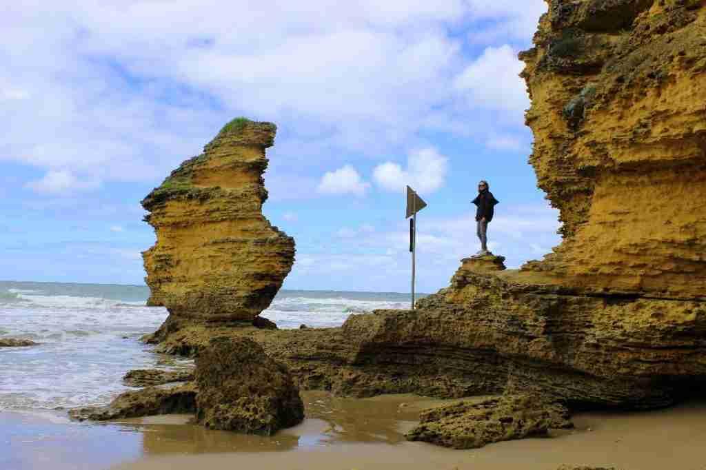 Eva on rocks below Split Point Lighthouse