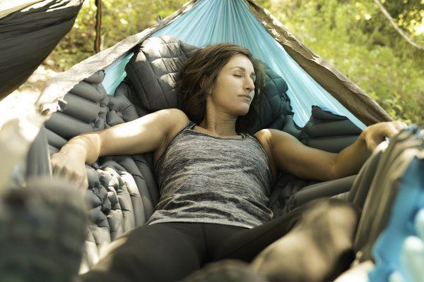 Woman laying in Hammock Sleeping Pad