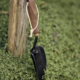 Small Camping Spade outside on grass