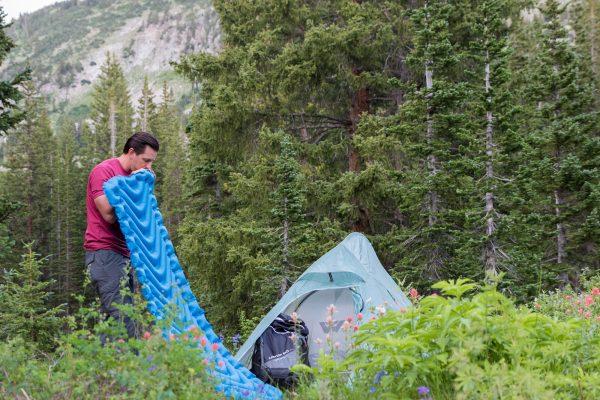 Super Lightweight Sleeping Mat next to camping tent