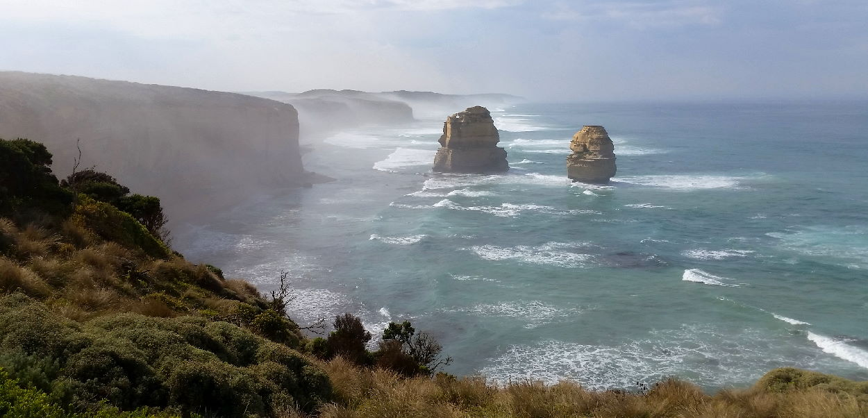 Morning fog rolling off the cliffs and over Gog and Magog on the Great Ocean Road