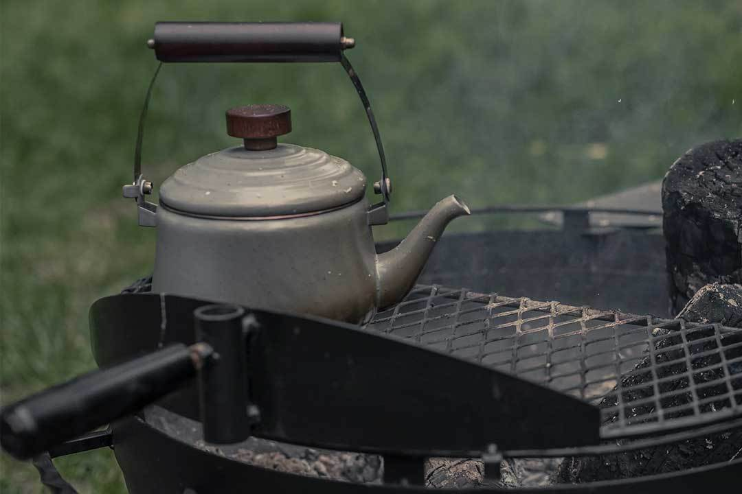 Boiling water on the fire with an Enamel Teapot