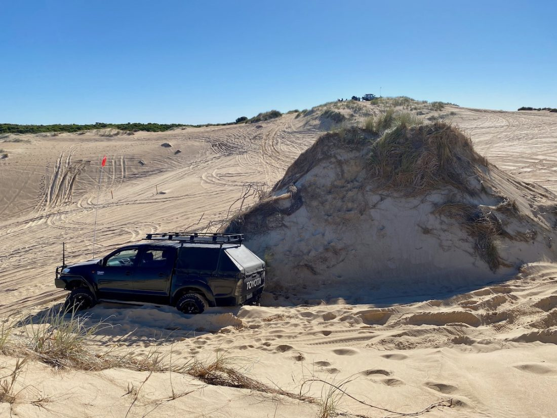 Car bogged in dunes