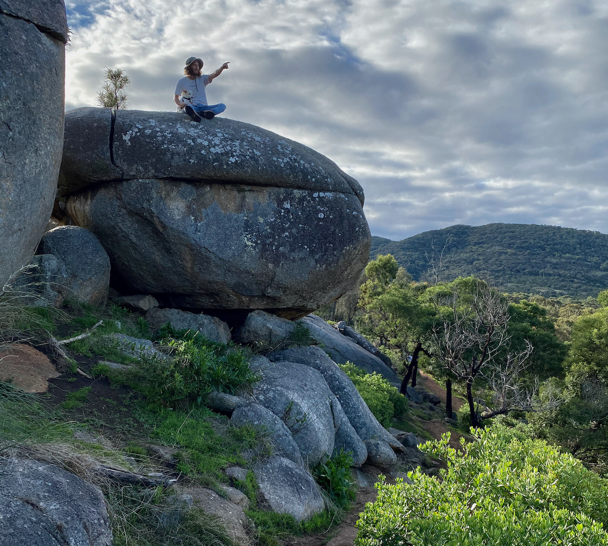 Guy sitting on a rock at the You Yangs Regional Park