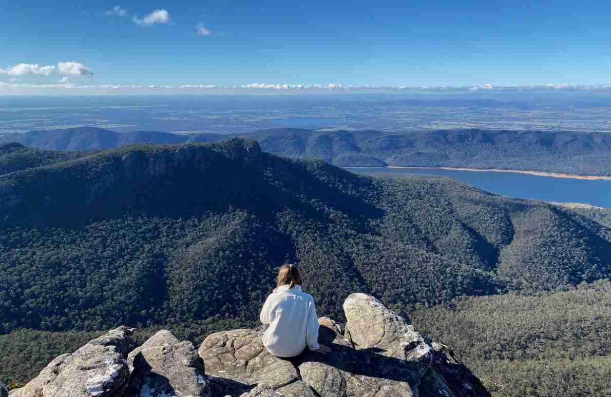 Eva sitting on the Mount Rosea summit