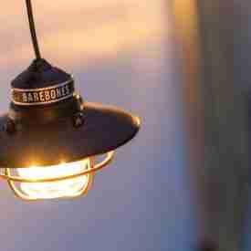 Hanging Antique Bronze Steel Lantern turned on